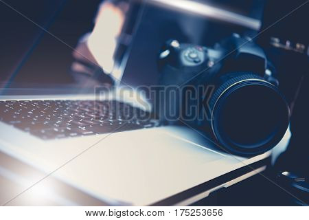 Microstock Photo Business Concept Photo with DSLR Camera and Modern Laptop Workstation For Photography Editing.