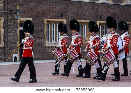 LONDON, GREAT BRITAIN - MAY 12, 2014: The Military Orchestra of the Royal Guard marches on the changing of the guard at Buckingham Palace.