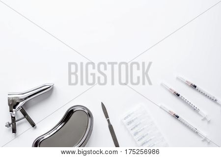 instruments of gynecologist on white background top view mock up.