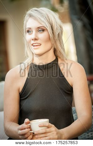 Blonde Girl Holding A Coffee Cup