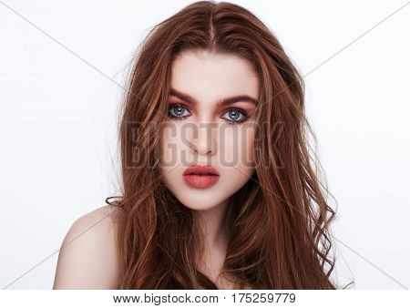 Ginger red long hair.Fashion beauty portrait red lips on white background