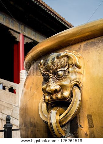 Beijing, China - Oct 30, 2016: Cloesup of ornate bronze handle on water urn at the Entrance to the Gate of Heavenly Purity, or Celestial Purity (Qianqingmen). Forbidden City (Gu Gong, Palace Museum).