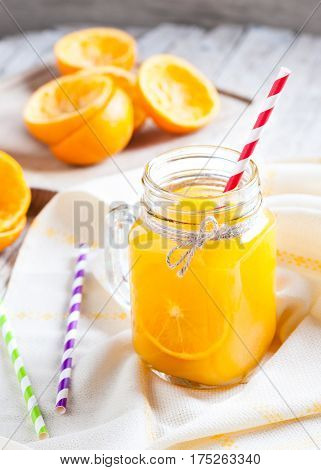 juice of Orange squeezed in container of glass on table of wood