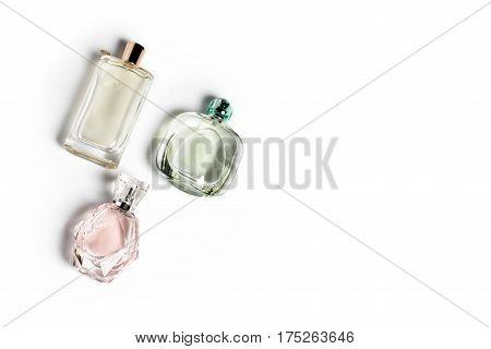 Perfume bottles on light background. Perfumery, cosmetics, fragrance collection. Free space for text