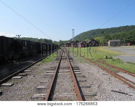 An  Old  Narrow  Gauge  Track  Along  Side  of  Coal  Cars,  Orbisonia,  Pennsylvania.