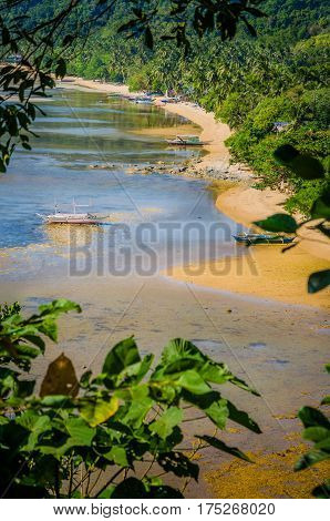 Banca Boats in Low Tide on Corong Corong Sandy Beach. Landscape of El Nido. Palawan Island. Philippines.