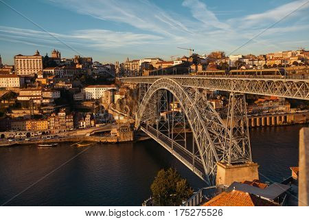 View of old Porto downtown and Douro river with Dom Luis I Bridge, Portugal.