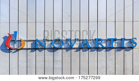 Basel, Switzerland - 27 August, 2016: sign on the wall of a Novartis building. Novartis International AG is a Swiss pharmaceutical company based in Basel, Switzerland, ranking number one in sales in the pharmaceutical industry worldwide.