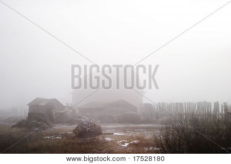 Winter farmyard in fog contains noise at full size