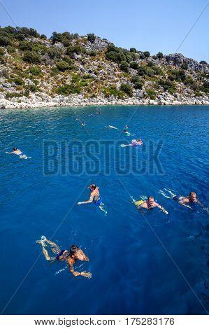 Antalya Turkey - 28 august 2014: Yacht passengers basking in Mediterranean waters during sea sightseeing walks.