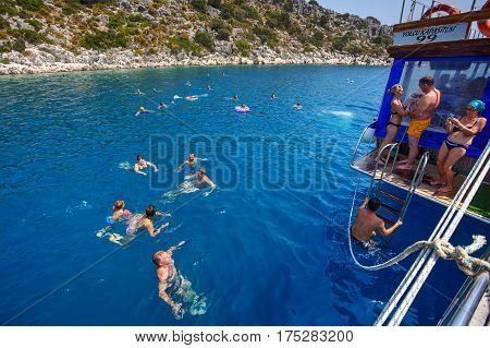 Antalya Turkey - 28 august 2014: Passengers pleasure boat bathed in the waters of the Mediterranean Sea during a sightseeing walk.