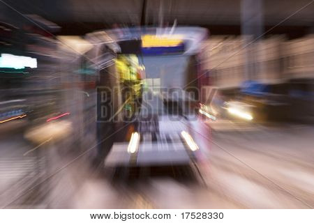 A blurred abstract image of a streetcar in Oslo, Norway