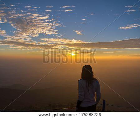 Traveler women see the mountain veiw in the sunrise
