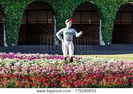 DEL MAR, CALIFORNIA - NOVEMBER 25, 2016:  Pacific Classic jockey statue painted in the colors of California Chrome in the paddock area of the Del Mar racetrack.