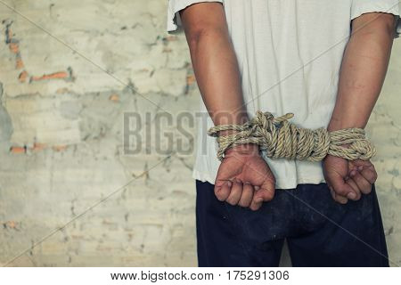 Tied Rope Hands Of Abused Man