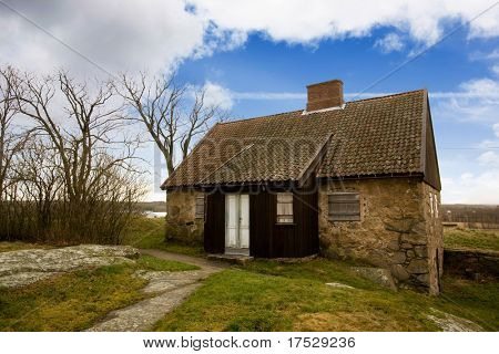 An old stone house on a big landscape