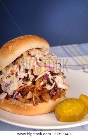 Pulled Pork Sandwich With Cole Slaw And Pickle