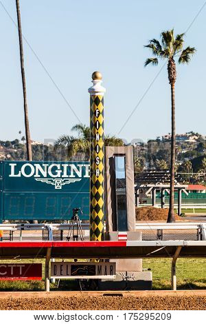 DEL MAR, CALIFORNIA - NOVEMBER 25, 2016:  Photo finish camera and finish line at the Del Mar horse racing track.