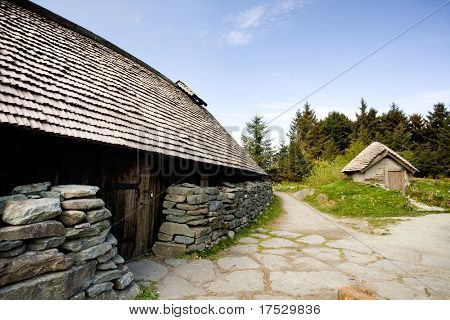 An old norwegian viking farm with two typical buildings