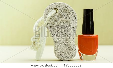 Feet nails care. Pedicure accessories set tools: bar of soap varnish and stone pumice with foot print