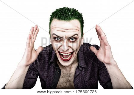 guy with crazy joker face, green hair and idiotic smike. carnaval costume.