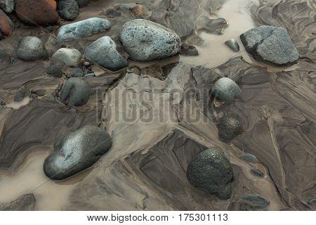 IL and stones on the bottom of river Studenaya. Kamchatka Peninsula.