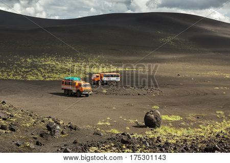Kamchatka Peninsula, Russia - August 20, 2016: Kamaz trucks in the parking lot for tourists. North Breakthrough Great Tolbachik Fissure Eruption 1975