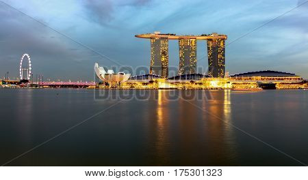 2017 January: wide angle view of the Art Museum Marina Bay Sands and Marina Bay Conference center with the Singapore flyer and the DNA aka. helix bridge in the distance