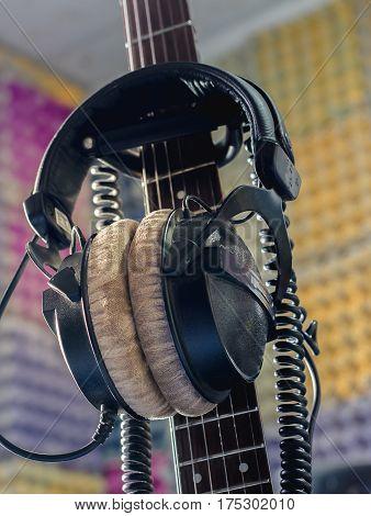 Earphones With Neck Guitar In The Studio.