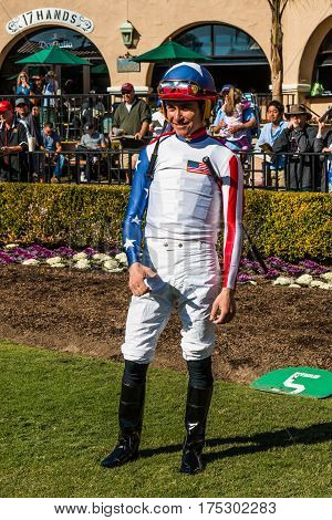 DEL MAR, CALIFORNIA - NOVEMBER 25, 2016:  Jockey posing in paddock area at the Del Mar racetrack.
