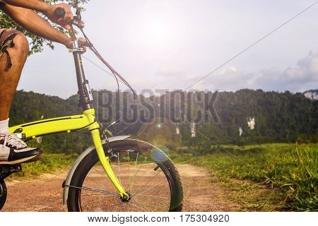 Body part man with his bike and background of nature.Concept and idea.