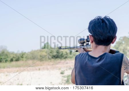 A shooter sighting in the target Long distance