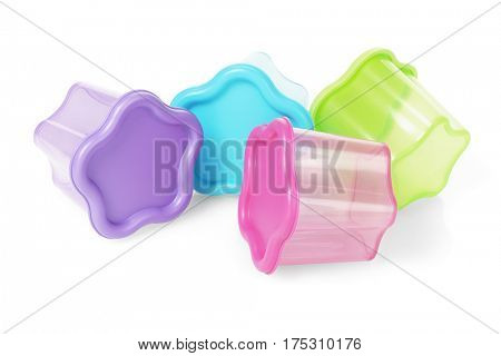 Colorful Floral Shape Plastic Containers Lying on White Background