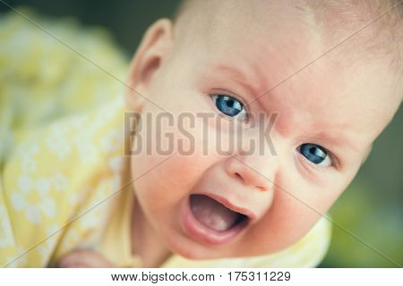 Portrait of crying baby girl - sad child