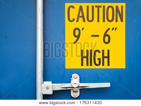 High Warning On Blue Cargo Container