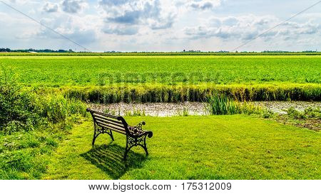 Typical Polder landscape at the historic village of Midden Beemster in the Beemster Polder in the Netherlands