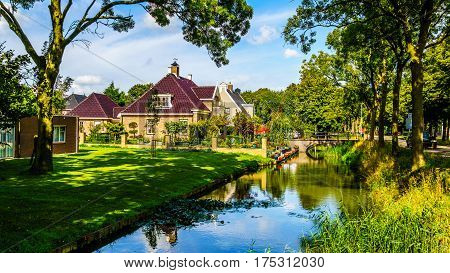 Typical scene of a canal and houses in a Polder in the historic village of Midden Beemster in the Beemster Polder in the Netherlands