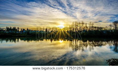 Sunset on a clear winter day over the Bedford Channel at Fort Langley, a side arm of the Fraser River in British Columbia, Canada