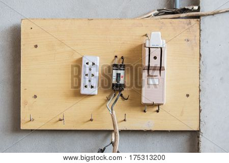 Electricity breaker box installed on wooden not safety