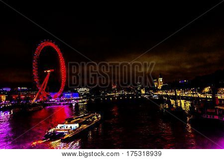 LONDON, ENGLAND - JANUARY 16, 2017 Big Eye Ferris Wheel Boat Thames River Westminster Bridge Night Westminster London England.