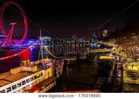LONDON, ENGLAND - JANUARY 16, 2017 Big Eye Ferris Wheel River Boats Thames River Westminster Bridge Night Westminster London England.