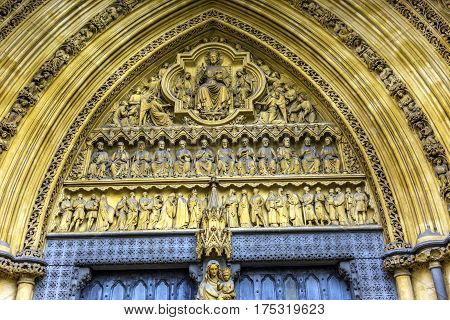Mary Statue Door Facade Westminster Abbey Church London England. Westminister Abbey has been the burial place of Britain's monarchs since the 11th century and is the setting for many coronations and weddings.