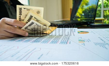 Woman Is Counting Money With Statement Paper Financial Concept.