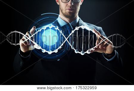 business, people, technology and cyberspace concept - close up of businessman in suit working with virtual reality screen and dna molecule projection over black background