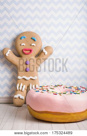 Funny gingerbread man and donut decorations for the party. Sweets. Birthday party or Christmas celebration. Photobooth.