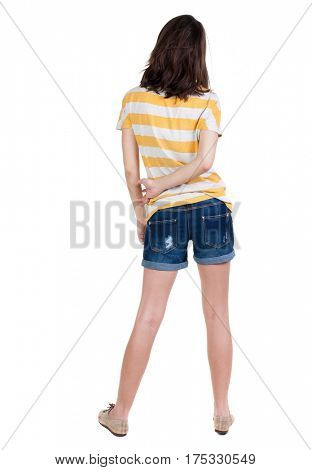 back view of standing young beautiful  brunette woman in yellow t-shirt. girl  watching. Rear view people collection.  backside view of person.  Isolated over white background.