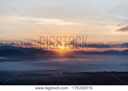 panorama of mountain with sunray in morning and fog