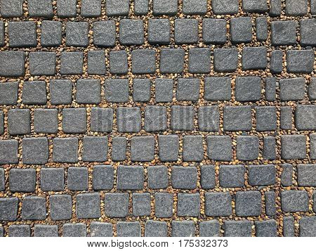 texture background of grey cobble stone and brown pebbles between pit