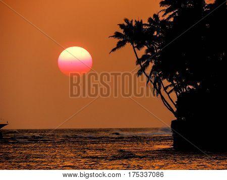 Sun setting at Diamondhead Beach Park, oahu