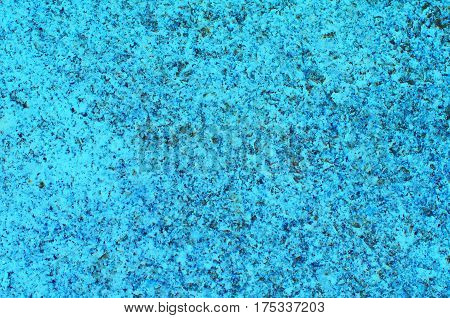 Texture of unpolished blue turquoise granite surface